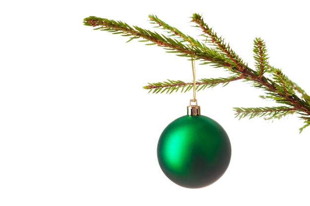 Decoration bauble on decorated christmas tree iso