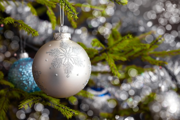 Decoration bauble on decorated christmas tree