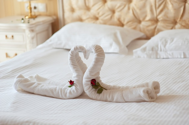 Decoration beds in the hotel two swans and heart of polotets