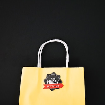 Decoration for black friday with yellow bag