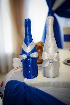 Decoration champagne bottles of bride and groom