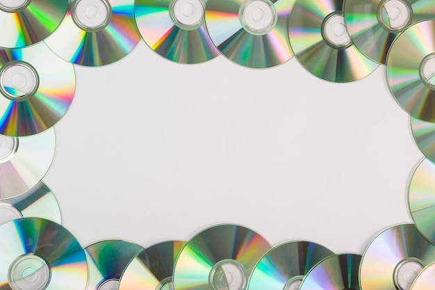 Decoration of compact discs with space for text on white background