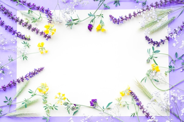 Decoration of flowers on white paper over the purple background