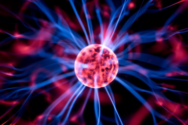 Decoration lamp in shape of plasma ball with red and blue electrodes, close-up