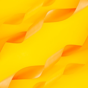 Decoration of curled ribbons on yellow backdrop