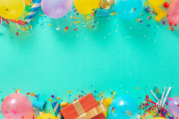 Decoration party. frame background of balloons and various party decorations top view