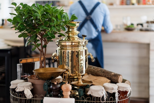 Decoration in restaurant with russian samovar. tea drinking table setting