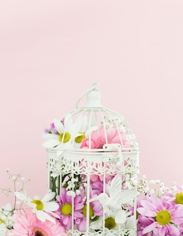 Decoration with bird cage full of flowers