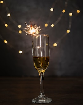 Decoration with champagne glass and fireworks
