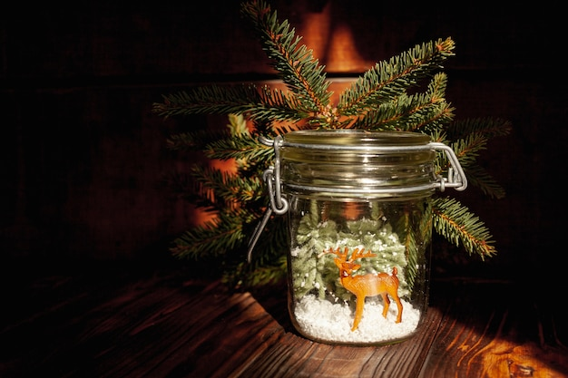 Decoration with festive jar with branches and deer