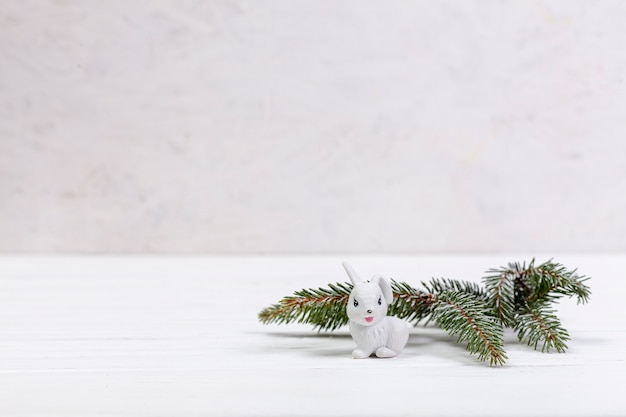 Decoration with fir tree twig and white rabbit
