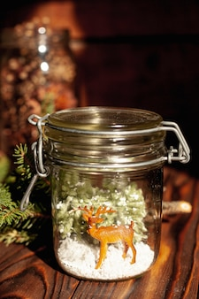 Decoration with jar and deer toy