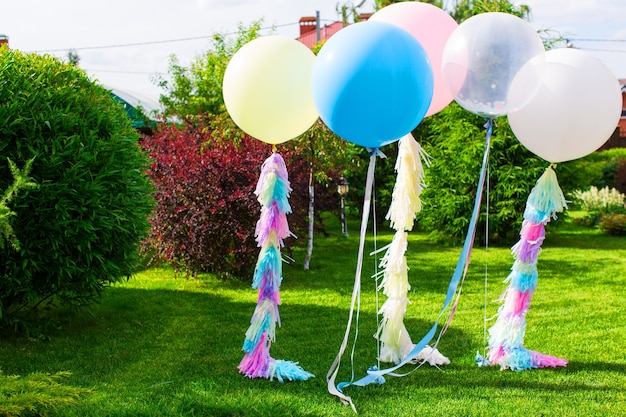 Decorations of large balloons with helium for a holiday event in summer in nature