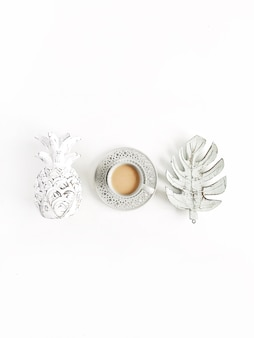 Decorations pineapple, coffee, monstera palm leaf on white background. flat lay, top view