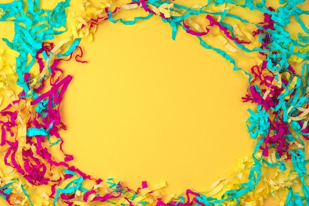 Decorative abstract background of colored paper on a yellow background
