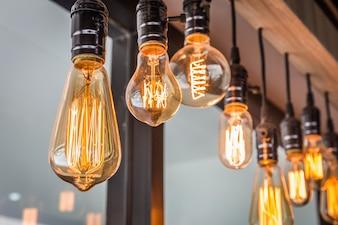 Decorative antique edison style filament old lighting decor bulb in modern building.