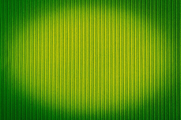 Decorative background green color, striped texture, vignetting gradient.