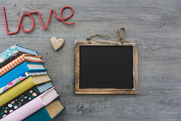 Decorative background with slate and books