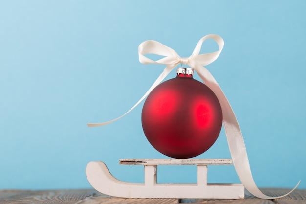 Decorative bauble on sleigh
