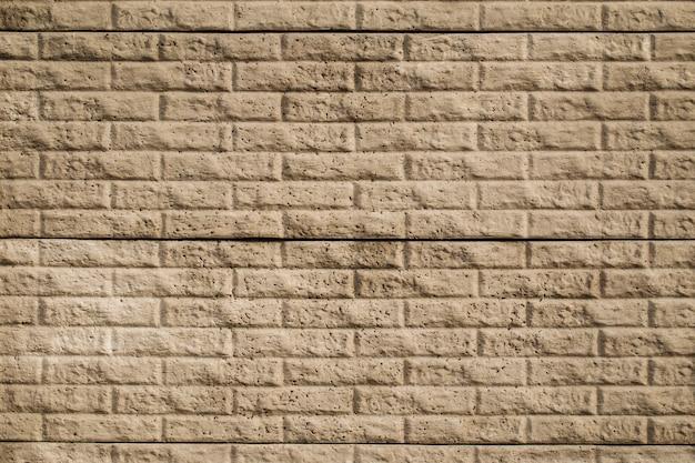 装飾的なベージュのタイルのレンガの壁のテクスチャ