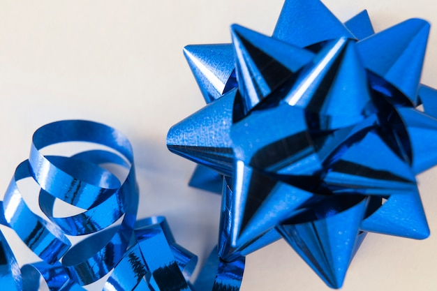 Decorative blue stain ribbon bow on white background