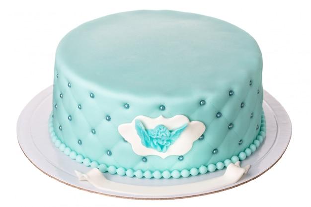 男の子の洗礼のための装飾的なケーキ。