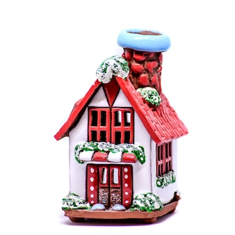 Decorative candlestick in the form of a house
