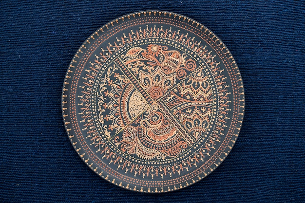 Decorative ceramic plate with black and golden colors