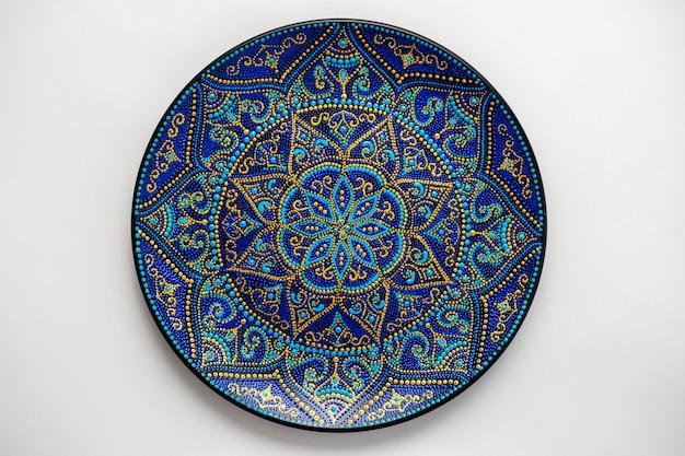 Decorative ceramic plate with black