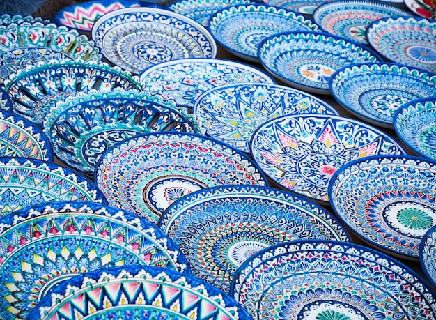 Decorative ceramic plates with traditional uzbekistan ornament on street market of bukhara. uzbekistan, central asia, silk road