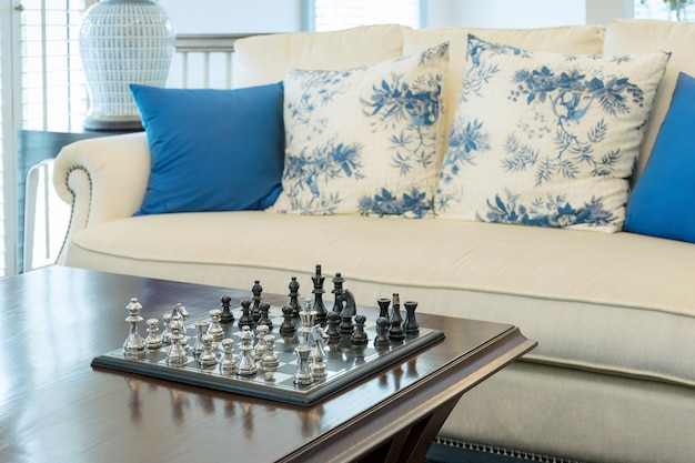Decorative chess board with chess pieces in luxury living room interior