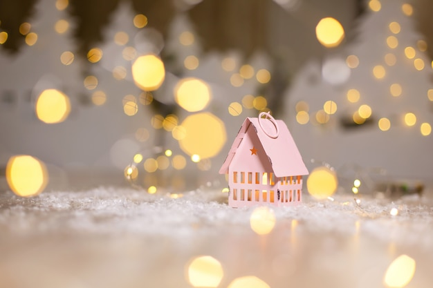 Decorative christmas-themed figurines. little toy house, christmas tale