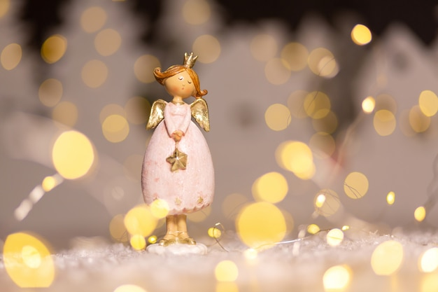Decorative christmas-themed figurines. statuette of a christmas angel