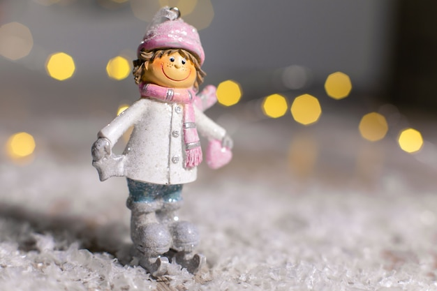 Decorative christmas-themed figurines. statuette of a man on skates.