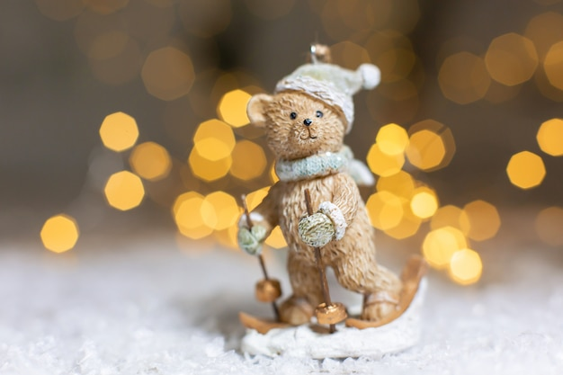 Decorative christmas themed figurines, statuette of a teddy bear skiing, christmas tree decoration, ,