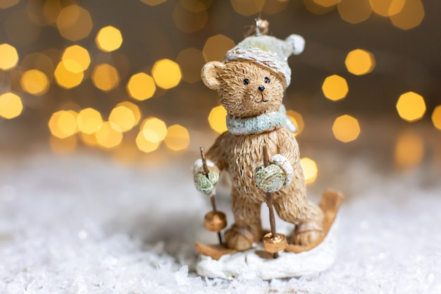 Decorative christmas-themed figurines. statuette of a teddy bear skiing