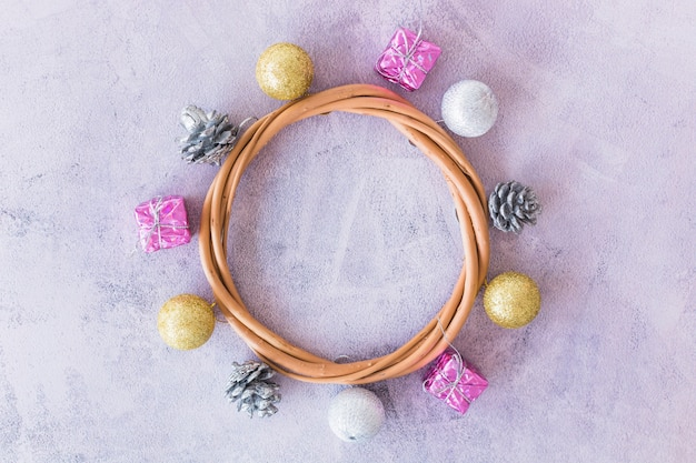 Decorative circle of dry twigs and christmas toys