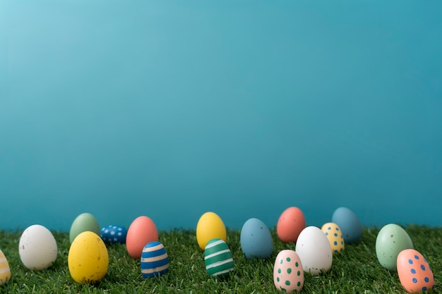 Decorative colored eggs on grass for easter day