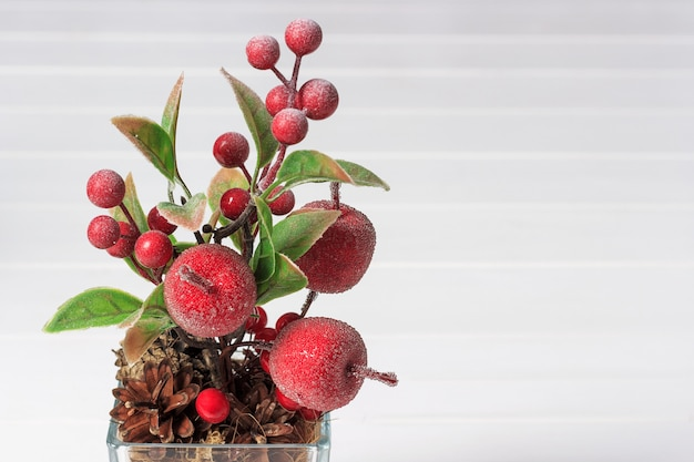 Decorative composition of artificial apples and berries