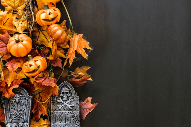 Decorative composition for halloween with tombstones and leaves