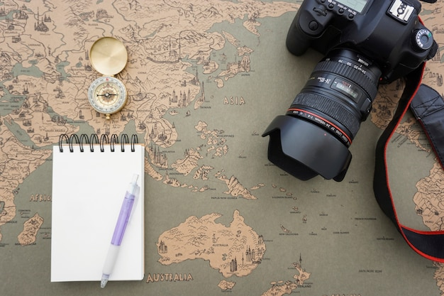 Decorative composition with blank notebook and travel items