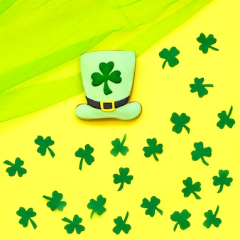 Decorative cookie on yellow. st. patrick's day concept