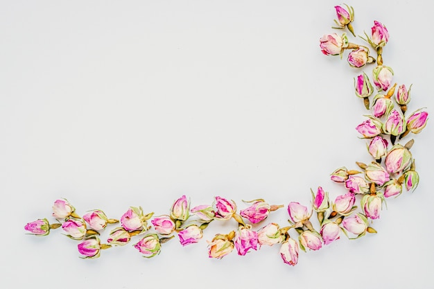Decorative corner frame made of buds dried roses background