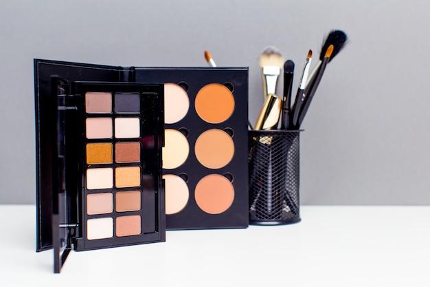 Decorative cosmetics on grey