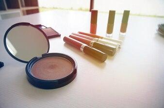 Decorative cosmetics makeup set on white table