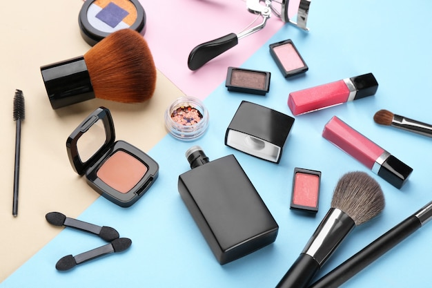 Decorative cosmetics and tools of professional makeup artist on color