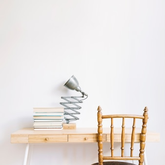 Decorative desk with books and lamp