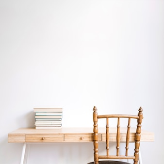 Decorative desk with chair and books