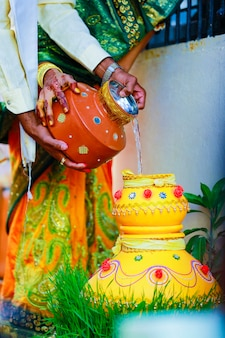 Decorative earth pitcher in wedding ceremony
