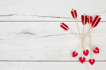Decorative feathers on wands with little hearts